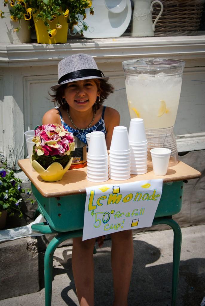 Adorable children selling lemonade? Check.
